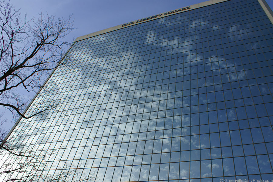Clouds are rolling in as seen in this reflection in One Liberty Square in Greenville, SC.  This photo was taken by Denton Harryman and posted at GreenvilleDailyPhoto.com on 1/29/2010.